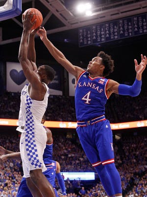 Kentucky forward Bam Adebayo (3) shoots the ball against Kansas guard Devonte' Graham (4) in the second half.