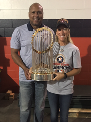 Battle Creek's Jana (Pearson) Powell with her  husband Houston Astros assistant hitting coach Alonzo Powell, with the World Series Championship trophy.
