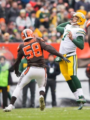 Green Bay Packers quarterback Brett Hundley (7) throws a pass for a touchdown under pressure from Cleveland Browns outside linebacker Christian Kirksey (58) during the first quarter at FirstEnergy Stadium.