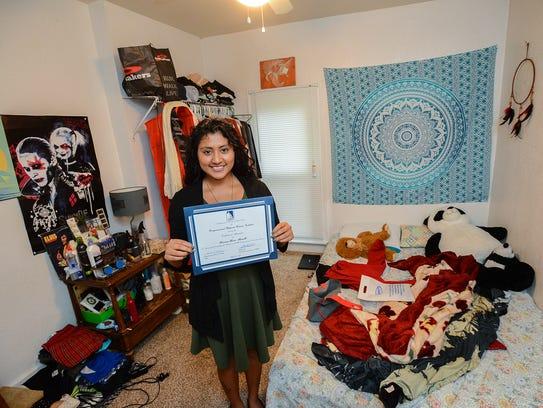 Viviana Alamillo, 23, stands in her bedroom Wednesday,