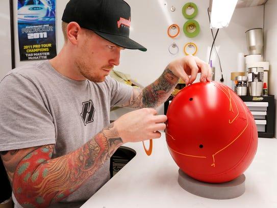 Austin Polen at work on a custom helmet design for