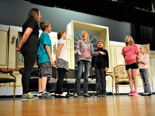 """Maria and the Von Trapp children in the musical """"The Sound of Music"""" under the direction of Colleen Pelton on Monday at Paynesville High School. The musical is a repeat of the first production led by Colleen's late husband, Ian, known for his inspirational directing."""