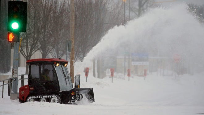 Snow gets cleared in Appleton during a spring blizzard across Wisconsin on April 15.