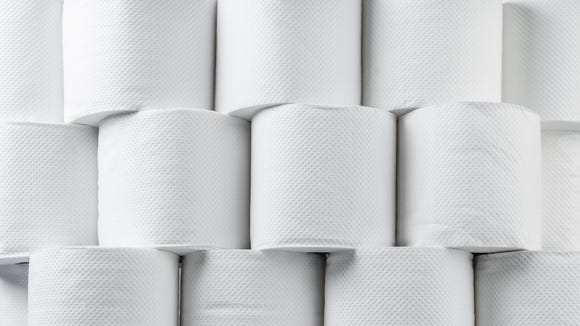 A stack of white toilet paper rolls.