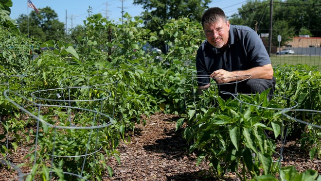 John Caldwell, chef at Through The Garden restaurant, is pictured in the garden behind the restaurant, Tuesday, July 17, 2018, in Blue Ash, Ohio.