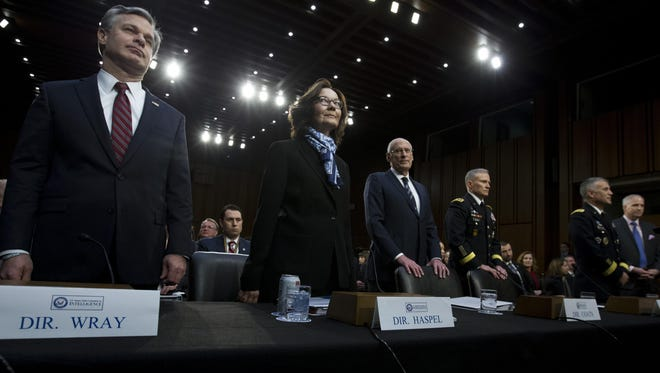 From left, FBI Director Christopher Wray, CIA Director Gina Haspel and Director of National Intelligence Daniel Coats, Defense Intelligence Agency Director Gen. Robert Ashley, National Security Agency Director Gen. Paul Nakasone and National Geospatial-Intelligence Agency Director Robert Cardillo testify before the Senate Intelligence Committee on Capitol Hill in Washington, Jan. 29, 2019.