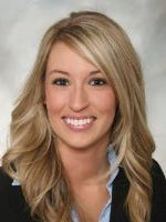 Ashley Okland was shot and killed during an open house at a townhome development in West Des Moines in April 2011.