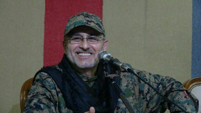 An undated handout photo released on May 13, 2016 by Hezbollah's media office shows Mustafa Badreddine smiling at an undisclosed location. Hezbollah on May 13, 2016 announced the death of its military commander Mustafa Badreddine in Syria.