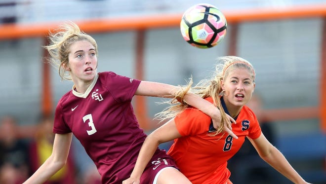 FSU's Megan Connolly fights for a ball against Syracuse in the 1-1 draw.