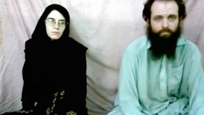 This still image made from a 2013 video released by the Coleman family shows Caitlan Coleman and her husband, Canadian Joshua Boyle in a militant video given to the family. The American woman, her Canadian husband and their three young children were released in October 2017 after years of being held captive by a network with ties to the Taliban. The two were abducted five years ago while traveling in Afghanistan and had been held by the Haqqani network.