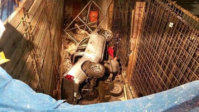 A man survived a crash after his truck plummeted 25 feet into a construction site early Saturday morning.