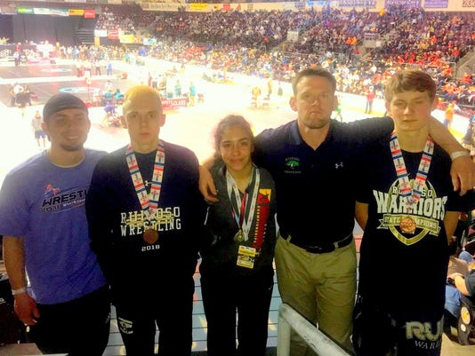 Ruidoso winning wrestlers at state meet