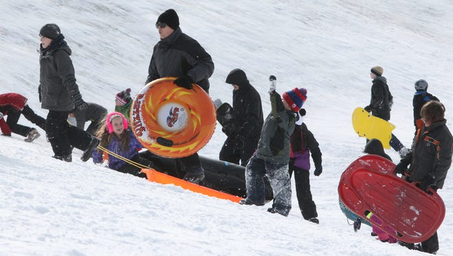 Sledding can be a fun and safe wintertime activity when precautions are taken.