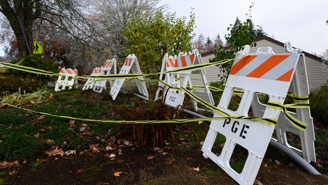PGE has taped off an area in South Salem near Schirle Elementary School as seen on Friday, Nov. 14, 2014.