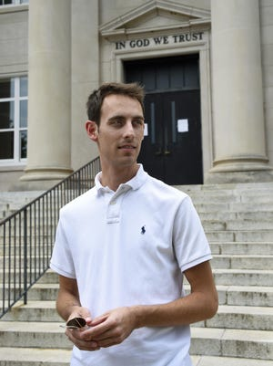 Matthew Fenner stands outside Rutherford County Courthouse after a hearing on his case against Word of Faith Fellowship church in Rutherfordton on May 19.