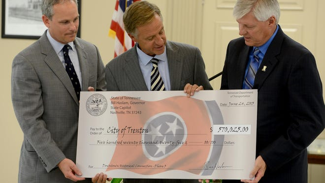 State Sen. John Stevens and Gov. Bill Haslam present a check in the amount of $570,025 to Mayor Ricky Jackson and the city of Trenton on Wednesday.