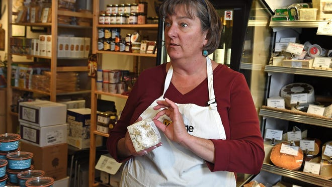 Laura Conrow, owner of Wedge Cheese Shop, discusses what makes a cheese an artisan cheese against cases and shelves brimming with products. Wedge, opened in July 2012, was a pioneer merchant in the new Midtown.