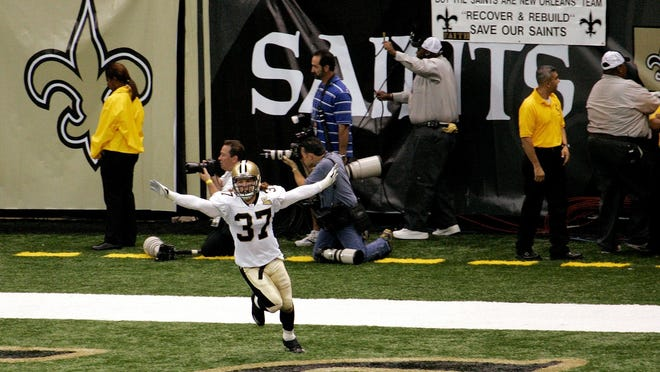 In this 2006 file photo, New Orleans' Steve Gleason celebrates after blocking an Atlanta punt at the newly reopened Superdome.