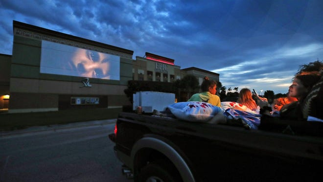 A family checks out a recent drive-in offering at Epic Theatres of West Volusia in Deltona. The company will continue to show drive-in movies at its theaters in Deltona, St. Augustine, Mount Dora and Clermont while awaiting new releases from major movie studios.