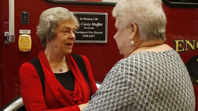 Northport Mayor Donna Aaron speaks with Nancy Moffitt during a dedication of Engine 1 in memory of Moffitt's son, Lt. Curry Moffitt, at Northport Fire Station No. 1 on Monday, Sept. 11, 2017.