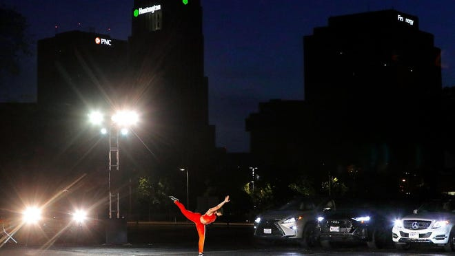 """Nicole Hennington of GroundWorks performs in """"Jigsaw"""" at a downtown Akron parking lot Saturday."""
