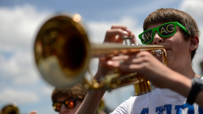 At right, Jacob Christopherson and other members of the Green Bay East High School marching band practice at the school on Thursday. The band is preparing to play in the National Independence Day Parade on July 4th in Washington D.C.