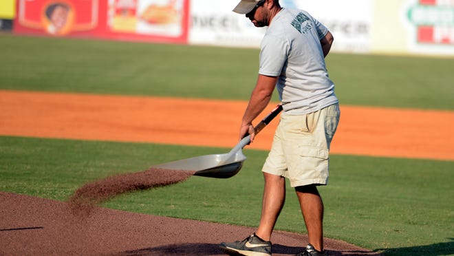 Jacksons Generals grounds crew member Phillip Dunn spreads a shovel full of dirt on the pitchers' mound before the start of a Generals game.