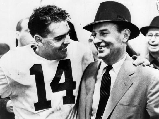 Paul Brown, right, with quarterback Otto Graham, lent