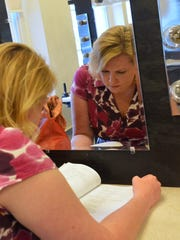 "Reflected in a mirror, Nancy Houseknecht studies her lines in the dressing room before going on stage for a rehearsal for ShenanArts production of ""Les Miserables"" on Tuesday, July 16, 2013."