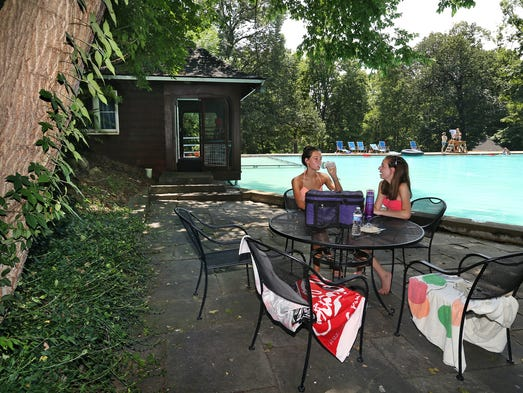 Sisters Emily (left), 14, and Rachel Efroymson, 16, enjoy a lovely summer day at the Lilly pool.