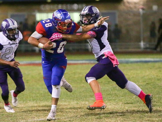 David Alvarado with a stiff arm. Shadow Hills 32, Indio 13 -- The Mayor's Cup will stay with the Knights!