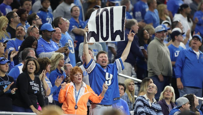 Lions fans celebrate in the fourth quarter of the team's 35-23 win over the Cardinals in the season opener Sept. 10 at Ford Field.