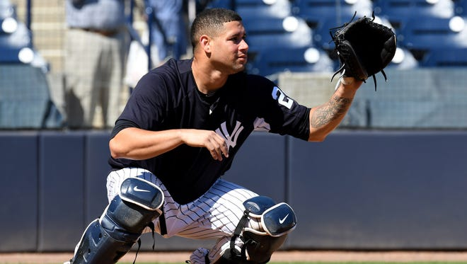 Yankees catcher Gary Sanchez waits for a throw during a workout at George M. Steinbrenner Field.