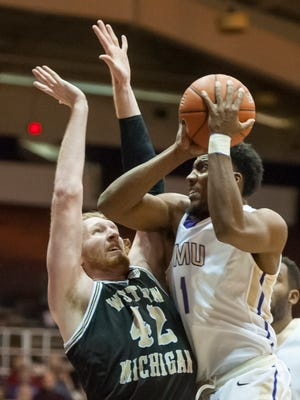 James Madison guard Shakir Brown (1) goes up for a shot against Western Michigan center Drake LaMont (42) during the first half of an NCAA college basketball game in Harrisonburg, Va., Thursday, Dec. 3, 2015. (Daniel Lin/Daily News-Record via AP) MANDATORY CREDIT