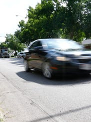 Traffic flows Tuesday afternoon on North Sixth Street