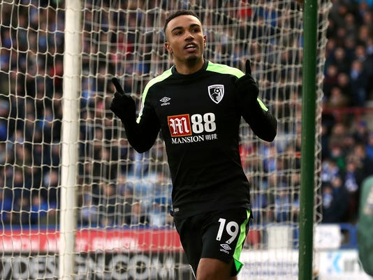 AFC Bournemouth's Junior Stanislas celebrates scoring his team's equalising goal during their English Premier League soccer match against Huddersfield at the John Smith's Stadium, Huddersfield, England, Sunday, Feb. 11, 2018. (Martin Rickett/PA via AP)