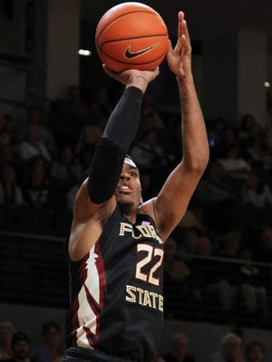 Florida State Seminoles guard Xavier Rathan-Mayes (22) shoots the ball against the Georgia Tech Yellow Jackets in the first half at McCamish Pavilion.