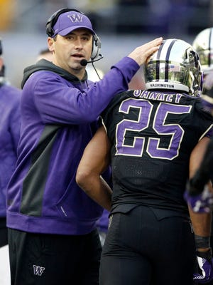 Steve Sarkisian, left, leaves  Washington with a 34-29 record.
