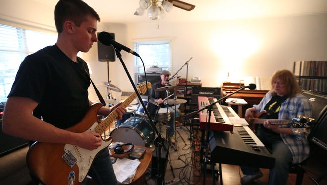 Left to right: Royce Johns, Steve Treanor and Buddy Franklin, members of the Des Moines-based rock band Lincoln Rockhouse, rehearses on April 13, 2015, at Franklin's home in Des Moines. The band is unique because guitar player Johns is 19 years old while Treanor and Franklin are both over the age of 55.