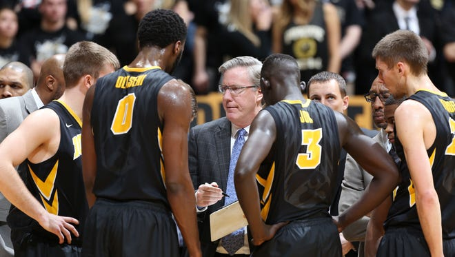Fran McCaffery huddles with his players while Aaron White was sidelined during Iowa's 67-63 loss at Purdue. The head coach got solid production from a smaller lineup as the Hawkeyes nearly rallied to win at Mackey Arena.