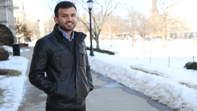 Sarmad Saadi stands on the sidewalk outside of the Old Capitol on Wednesday, March 4, 2015, in Iowa City. Saadi was educated to be a doctor in Iraq and he recently moved to Iowa City.