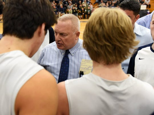 Wayne Valley coach Joe Leicht gives his team some pregame advice.