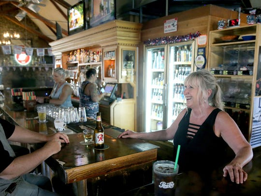 Our Place Pub and Eatery co-owner and general manager Jodi Derry talks with regular customer Joey VanVuren of Silverdale. He visits the pub three to four times a week.