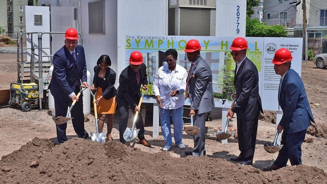 Peapack-Gladstone Bank will provide $525,000 in funds to Ingerman's development of The Residences at Symphony Hall, a four-story, 60-unit affordable rental community in Newark. Pictured is the recent groundbreaking ceremony.