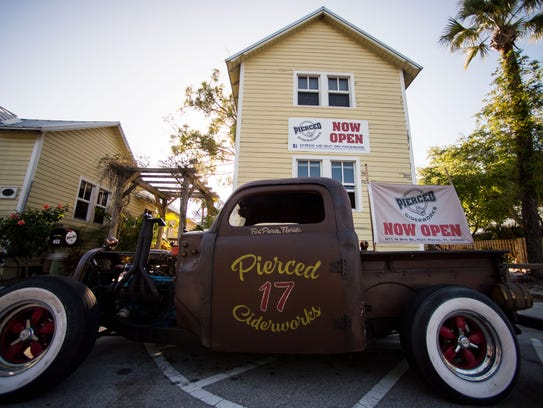 Pierced Ciderworks' rat rod sits out front of the Treasure