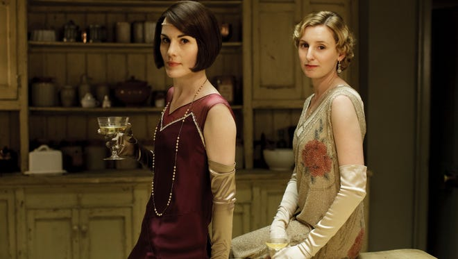 """Michelle Dockery as Lady Mary Crawley and Laura Carmichael as Lady Edith Crawley in the first episode of season 6 of """"Downton Abbey."""""""