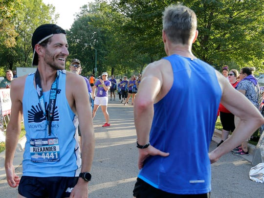 Alex Rink, left, winner of the Half Marathon talks with David Williams as the Fox Cities Marathon takes place Sunday, Sept. 24, 2017, on a course taking in Menasha, Appleton, Darboy, Kimberly, Combined Locks and finishing in Neenah, Wis.