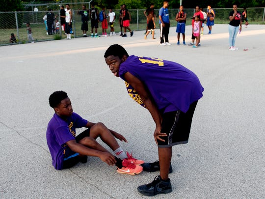 Lamoriante Finkley comforts Kyhli Maxey after their playoff loss at Meaux Park in Milwaukee.