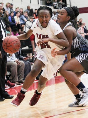 Westside freshman Keyshuna Fair, left, dribbles around Seneca senior Keyia Goodine during the third quarter on Wednesday at Westside High School in Anderson.