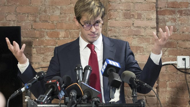 Milo Yiannopoulos speaks during a news conference on Tuesday in New York. Yiannopoulos has resigned as editor of Breitbart Tech after coming under fire from other conservatives over comments on sexual relationships between boys and older men.